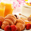 Breakfast with croissants cup of coffee and fruits — Stock Photo