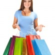 Young happy woman with colorful paper shopping bags isolated — Stock Photo #29382549