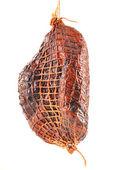 Piece of ham isolated on white — Stock Photo