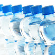 Composition with empty polycarbonate plastic bottles of mineral — Stock Photo #29959435