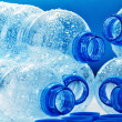 Composition with empty polycarbonate plastic bottles of mineral — Stock Photo #29959863