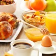 Breakfast including coffee, bread, honey, orange juice, muesli a — Stock Photo #31492099
