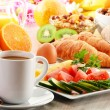 Breakfast with coffee, orange juice, croissant, egg, vegetables — Stock Photo #31494423