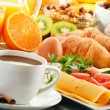 Breakfast with coffee, orange juice, croissant, egg, vegetables — Stock Photo #31496469