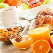 Breakfast including coffee, bread, honey, orange juice, muesli a — Stock Photo #31497765
