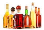 Assorted alcoholic beverages isolated on white — Stock Photo