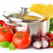 Stainless pot with spaghetti and variety of raw vegetables — Stock Photo #33241855