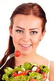Young woman eating vegetable salad — Stock Photo