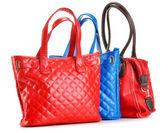 Three leather handbags isolated on white — Stock Photo