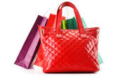 Paper shopping bags and handbag isolated on white — Stock Photo