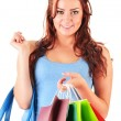 Young woman with shopping bags isolated on white — Stock Photo