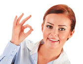 Young woman showing ok gesture isolated on white — Stock Photo