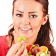 Young woman eating fruit salad — Stock Photo