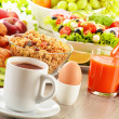 Breakfast with coffee, juice, croissant, salad, muesli and egg — Stock Photo