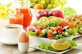 Breakfast with coffee, juice, croissant, salad, muesli and egg — Stock Photo
