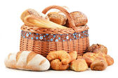 Wicker basket with baking products isolated on white — Stock Photo