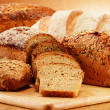 Wicker basket with bread and rolls Composition with bread and rolls. Baking products. — Stock Photo #35688709