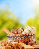 Wicker basket with variety of baking products — Stock Photo