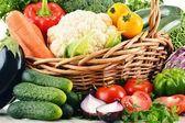 Variety of fresh organic vegetables in wicker basket — Stock Photo