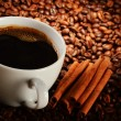Composition with cup of coffee and beans — Stock Photo
