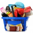 Variety of consumer products in plastic shopping basket isolated — Stock Photo