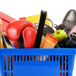Variety of consumer products in plastic shopping basket isolated — Stock Photo #36886701