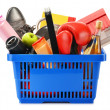 Variety of consumer products in plastic shopping basket isolated — Stock Photo #36886721