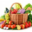 Wicker basket with assorted organic vegetables and fruits isola — Stock Photo #37971133