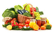 Wicker basket with assorted organic vegetables and fruits isola — Stock Photo