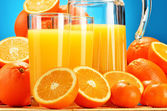 Composition with glasses of orange juice and fruits — Stock Photo