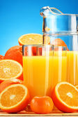 Composition with glasses of orange juice and fruits — Foto Stock