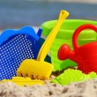 Plastic children toys on the sand beach — Stock Photo #37981561