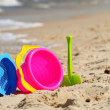 Plastic children toys on the sand beach — Stock Photo #37981643