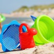 Plastic children toys on the sand beach — Stock Photo #37981707