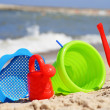 Plastic children toys on the sand beach — Stock Photo #37981767