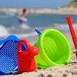 Plastic children toys on the sand beach — Stock Photo #37981829