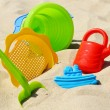Plastic children toys on the sand beach — Stock Photo #37981917