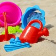 Plastic children toys on the sand beach — Stock Photo