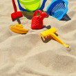 Plastic children toys on the sand beach — Stock Photo #37982203