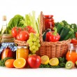 Composition with variety organic vegetables and fruits in wicker — Stock Photo #38200605
