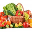 Composition with variety organic vegetables and fruits in wicker — Stock Photo