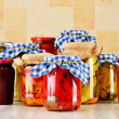 Jars of marinated food. Pickled vegetables and jams — Stock Photo #38615439