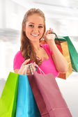 Young woman with shopping bags in the store — Stock Photo
