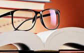 Composition with glasses and books on the table — Stock Photo