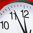 Wall clock showing five to twelve — Stock Photo