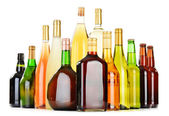 Bottles of assorted alcoholic beverages isolated on white — Stock Photo