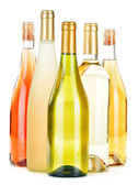 Composition with variety of wine bottles isolated on white — Stock Photo