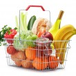 Wire shopping basket with groceries isolated on white — Stock Photo #40975781