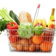 Wire shopping basket with groceries isolated on white — Stock Photo #40976103