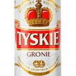 图库照片: Cof Tyskie beer isolated on white